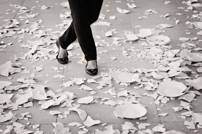 grayscale of woman in black flat sandals walking